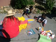 Chalk artists in front of Stockton Homeless Center