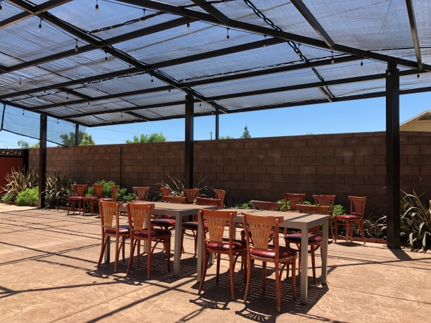 Outdoor patio space with tables and chairs