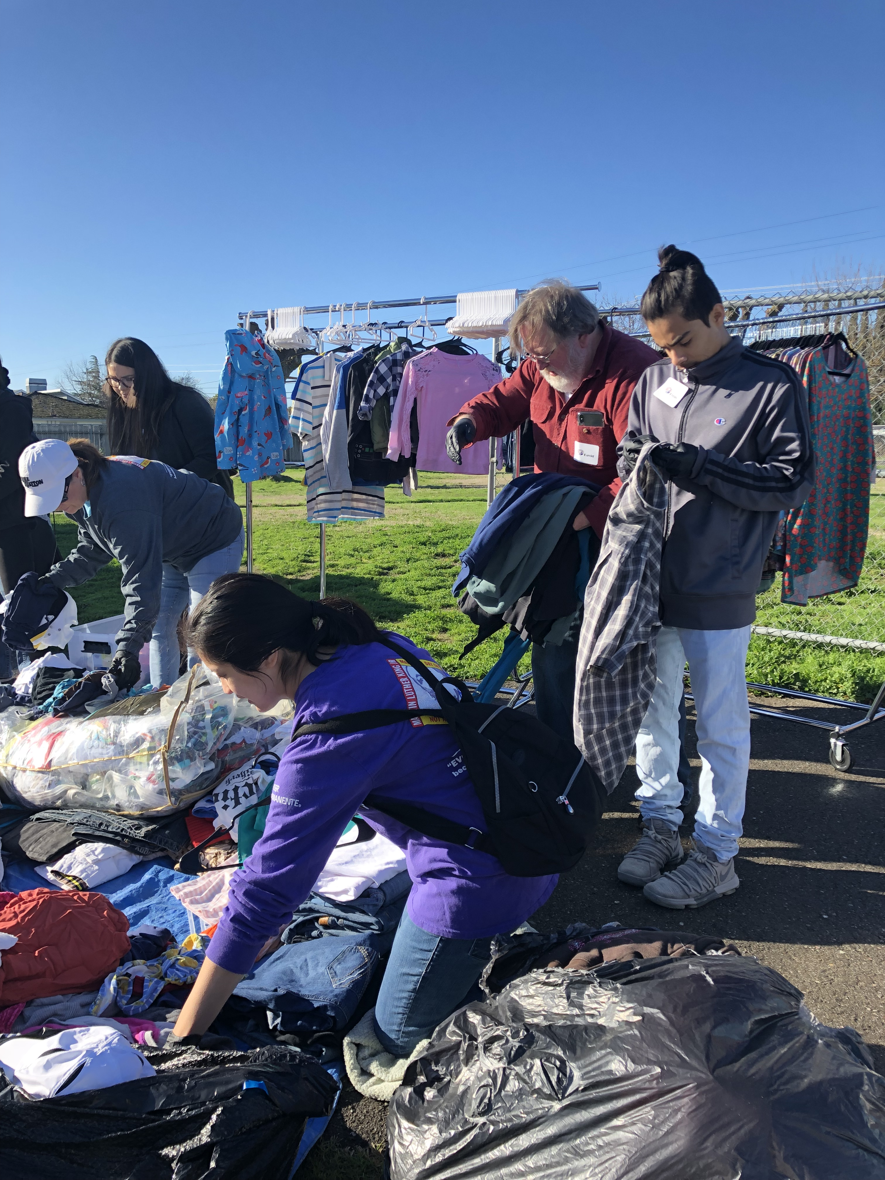 People separating clothing at a homeless shelter